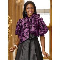 Shimmering taffeta with a beautiful flocked filigree design enhances the feminine, romantic silhouette of this dramatic top. Features a button front, an attached self tie at the neck, and elbow length puff sleeves. Pairs perfectly with palazzos or skirts for a dramatic and festive look youll love. 24 from center back neck. 100 polyester. Dry clean. Imported.